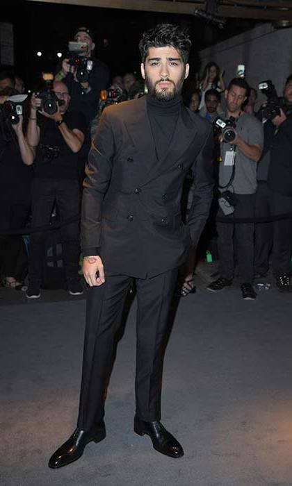 Zayn Malik debuted a new heavy beard in a black double breasted suit and roll neck jumper.