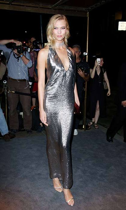 Karlie Kloss dazzled in a silver metallic halterneck gown.