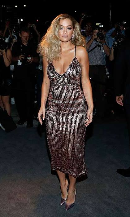 Rita Ora rocked molten metallics from head-to-toe for a glamorous front row look.