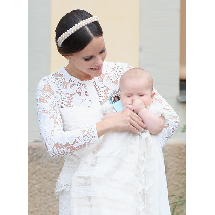 Sofia looked stunning in lace as she cuddled with her baby boy at Drottningholm Palace Chapel. 