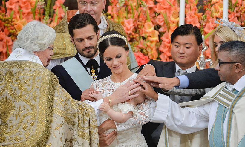 Prince Alexander was christened surrounded by his loving parents and godparents. 