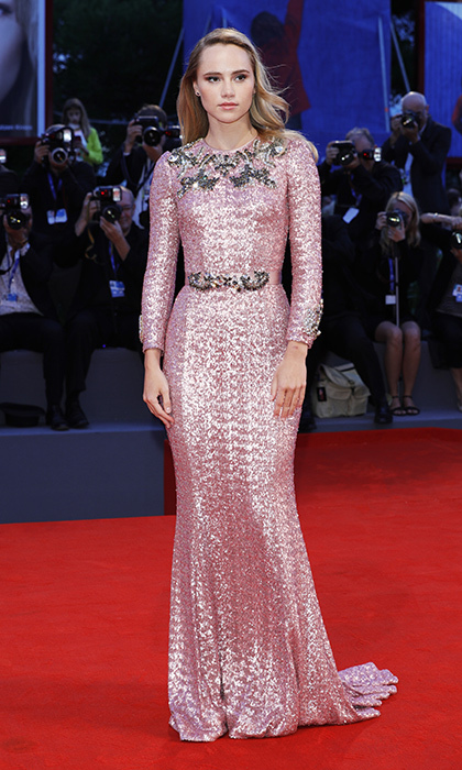 Suki Waterhouse was a romantic vision in long-sleeve pink sequin Dolce & Gabbana gown with silver embellishments at the premiere of <em>The Bad Batch</em> at the Venice Film Festival. 