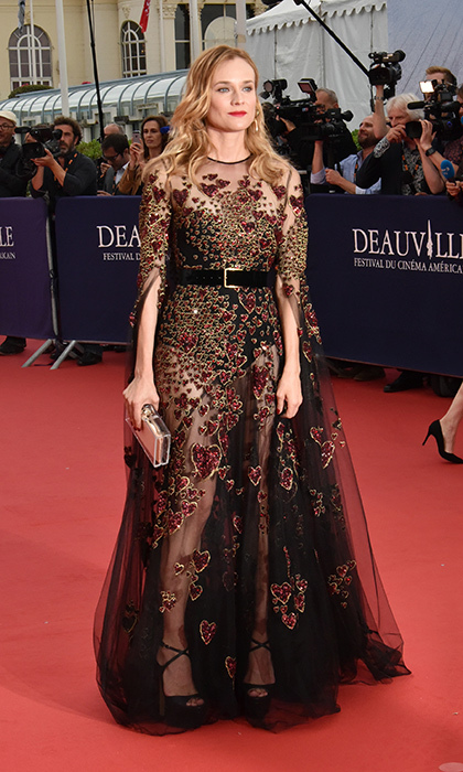 Diane Kruger was a queen of hearts in a sequinned Elie Saab couture gown and heels, which she paired with a metallic Charlotte Olympia clutch at the Deauville American Film Festival in France. 