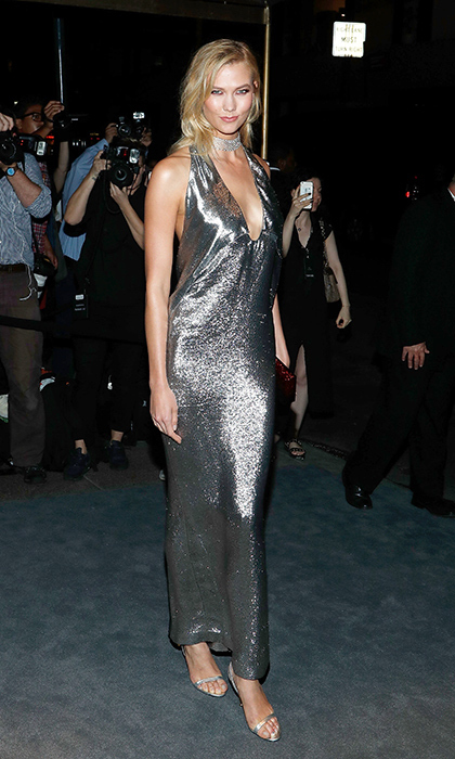 Karlie Kloss shined in a silver Tom Ford dress and matching metallic heels at the designer's New York Fashion Week party. <p>Photo: © Getty Images</p>