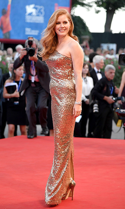 Amy Adams wass a true golden girl in a one-sleeve metallic Tom Ford gown, Bulgari jewels and gilded Jimmy Choo sandals at the premiere of <em>Nocturnal Animals</em> at the Venice Film Festival.  