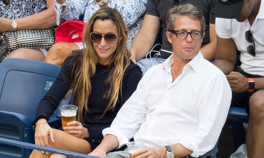 Hugh Grant and Anna Eberstein were spotted taking in a match on Day 7.