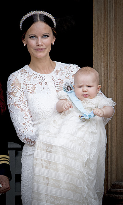 Princess Sofia looked gorgeous at the christening of her son Prince Alexander, wearing a white broderie anglaise dress and pearl headband.