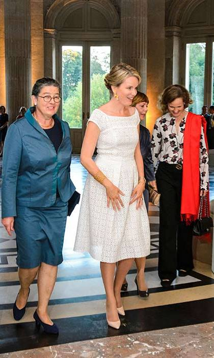 Queen Mathilde stepped out in a pretty white dress and nude heels for a gala dinner in Brussels.