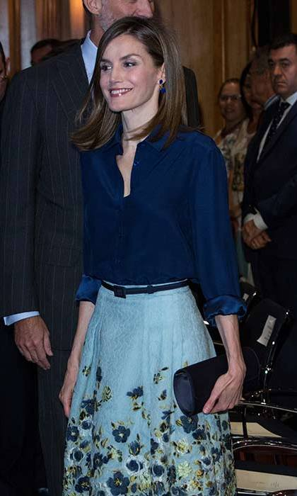 Queen Letizia puts a feminine spin on her formal look with a blue floral midi skirt.