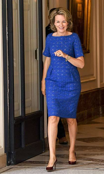 The Belgian royal adds a pop of colour to her wardrobe with this cobalt blue formal dress.