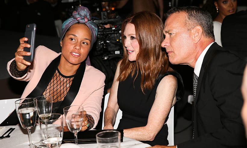 Selfie time! Alicia Keys, Julianne Moore and Tom Hanks hopped in a photo together at Tom Ford's cocktail party during New York Fashion Week. 