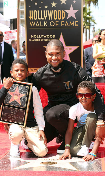 Usher celebrated his star on the Hollywood Walk of Fame with two of his biggest fans, sons Naviyd and Usher Jr. 