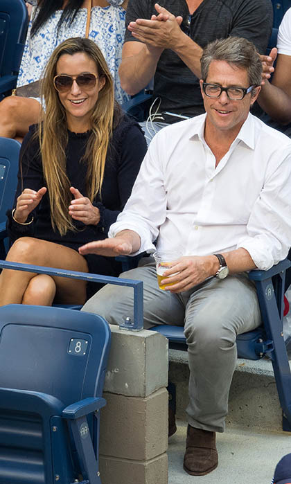 Tennis super fan Hugh Grant took in all the action at the US Open with girlfriend Anna Eberstein. 