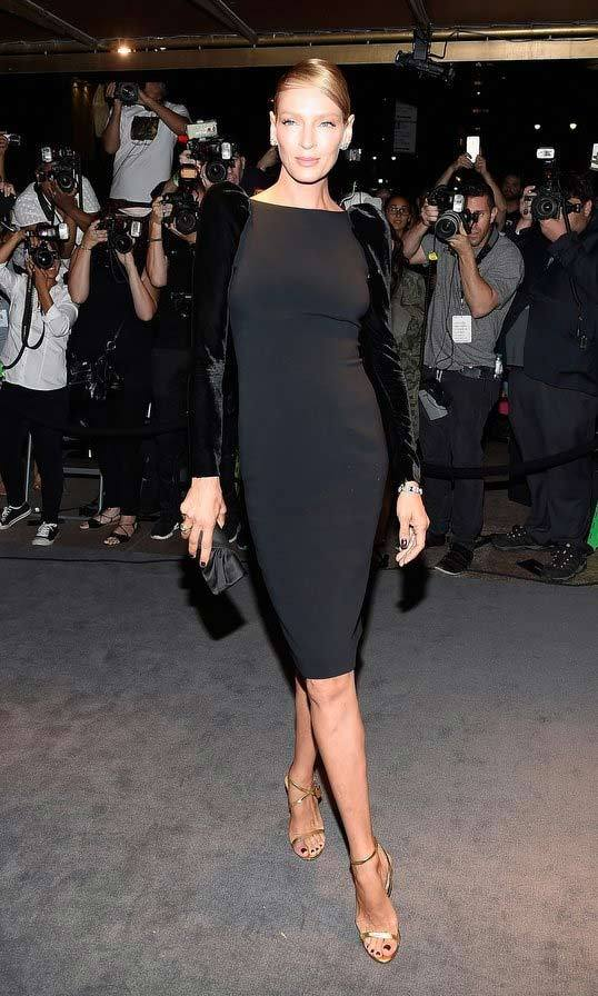 Uma Thurman showed off her statuesque silhouette before heading into the Tom Ford show.