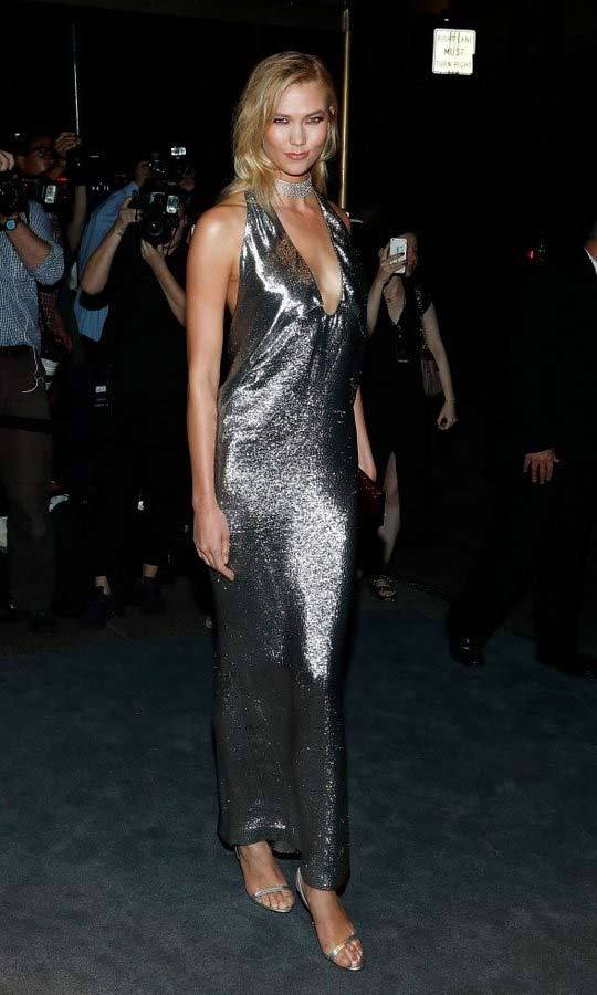 Karlie Kloss wore a molten silver Tom Ford halter gown to the designer's show.