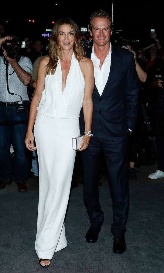 Also wearing a Tom Ford halter gown was Cindy Crawford, who arrived with husband Rande Gerber.
