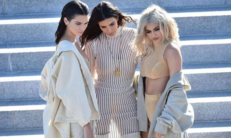 Kanye's angels! Kendall Jenner, Kim Kardashian and Kylie Jenner posed prior to taking their seats at the Yeezy Season 4 show.