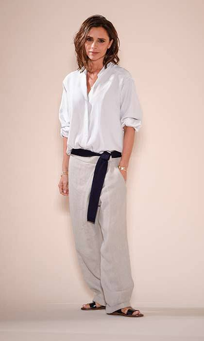 Victoria Beckham wore slouchy trousers and a white shirt to present her latest collection at Cipriani on Sunday.