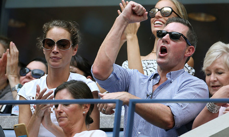 Christy Turlington and husband Ed Burns cheered from their seats in front of Karolina Kurkova during the women's final match. 