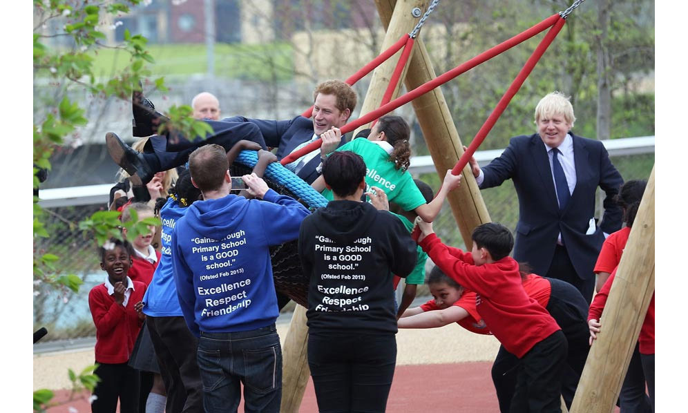 The eligible bachelor, who is great with children, embraced his inner kid as he opened a new playground in Newham, London with former mayor Boris Johnson.