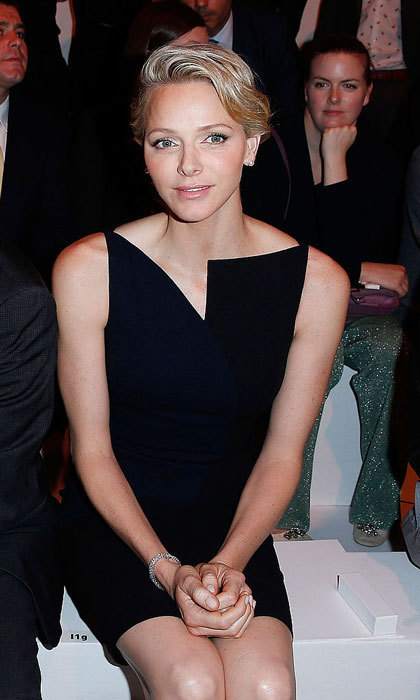 Princess Charlene of Monaco looked trés chic wearing a black dress featuring an asymmetrical neckline to the Akris show during Paris Fashion Week Womenswear Spring/Summer 2014.