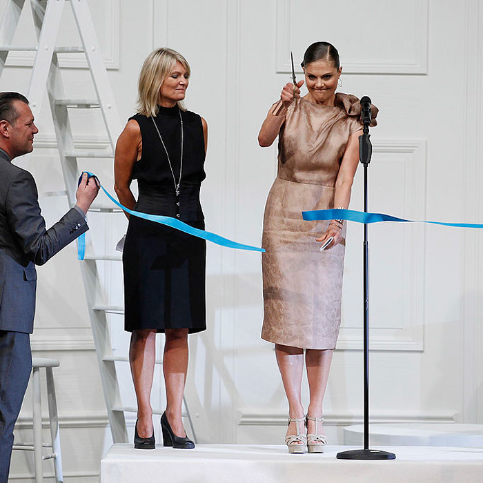 Crown Princess Victoria of Sweden cut a ribbon at the Fadi El Khoury S/S 2013 Fashion Show during the Mercedes-Benz Stockholm Fashion Week in Sweden.