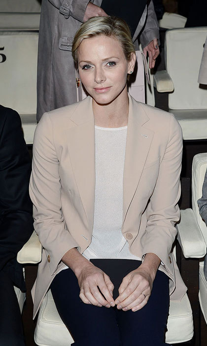 Princess Charlene looked effortlessly chic wearing a blush-colored blazer paired with a creme knit top and dark trousers to the Giorgio Armani fashion show during Milan Fashion Week Womenswear Fall/Winter 2013/14.