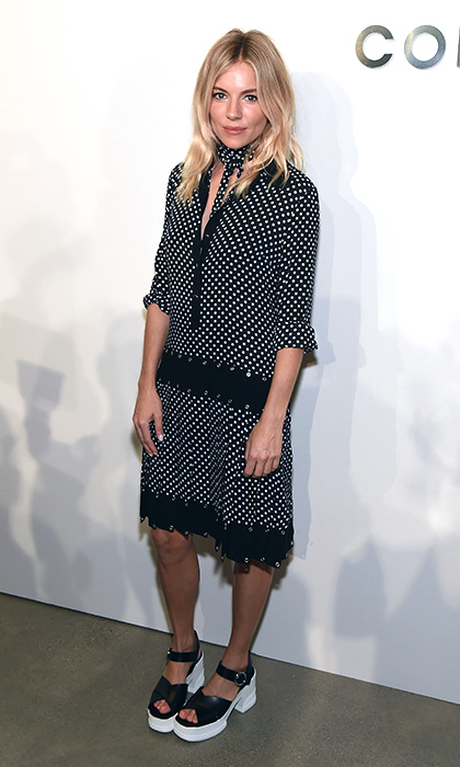 Sienna Miller channeled polished bohemian vibes in a pleated, polka-dot Michael Kors Collection dress with a coordinating scarf at the designer's Spring 2017 show during New York Fashion Week. <p>Photo: © Getty Images</p>