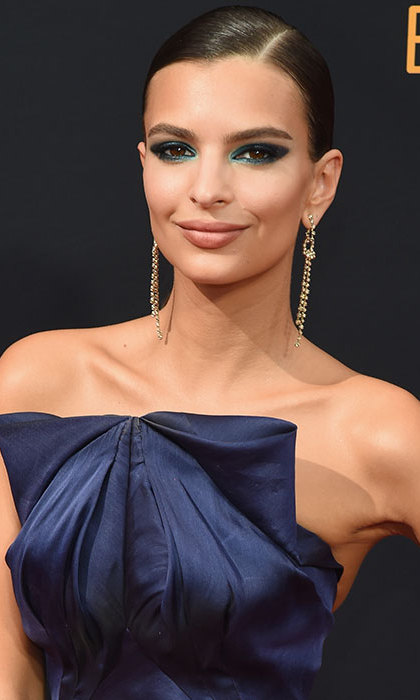 Emily Ratajkowski pulled out all the stops for the glitzy ceremony with statement blue eyeliner, sultry smoky eyes, and a super sleek, poker straight low ponytail. 