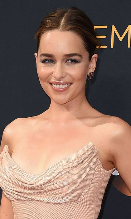 Emilia Clarke could have stepped out of old Hollywood with her flawless winged eyeliner, shimmering complexion and pale nude lips, perfectly complemented by the elegant chignon hairstyle she chose for the evening. 
