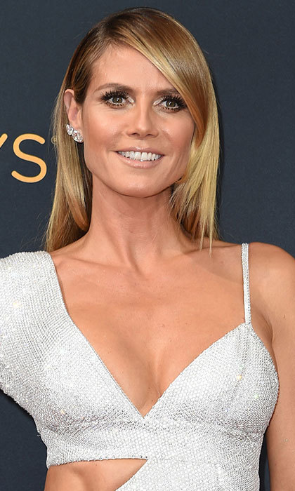 Heidi Klum had us reaching for the straighteners in a bid to recreate her stick-straight hairstyle – take note from the star and leave a few front strands in a natural curl to add a touch of volume. 