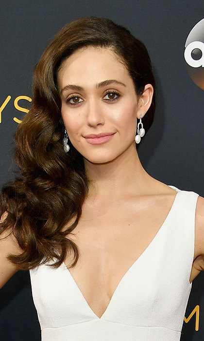 Emmy Rossum turned heads with her hair worn down in loose, cascading waves and swept to the side for an added dose of drama. 