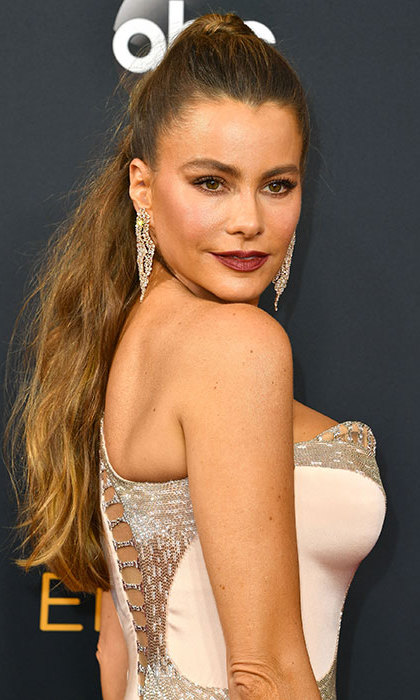 Sofia Vergara kept a laid-back haistyle thoroughly glamorous by pairing her half updo, tied high on the head, with a vampy dark-berry lipstick.