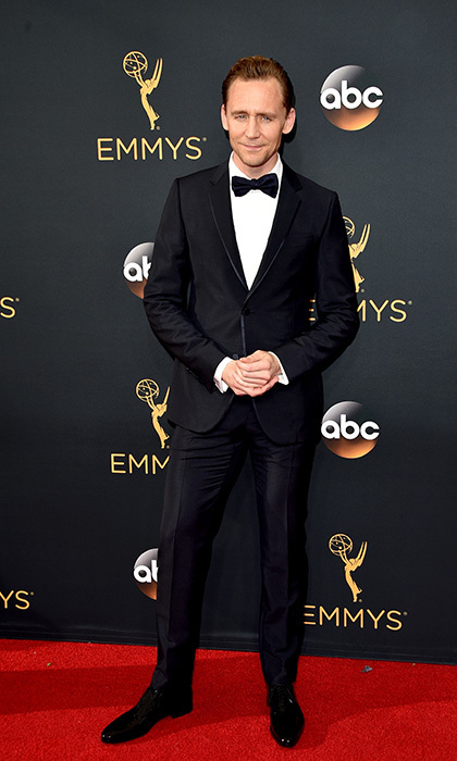Tom Hiddleston was among the stars on the red carpet at the 2016 Emmy Awards – his first official public appearance since his split from Taylor Swift earlier this month. The actor, who was nominated for his role in <em>The Night Manager</em>, was all smiles as he posed for photographers before heading inside for the ceremony.