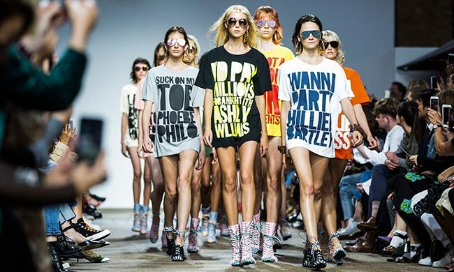 Over at House of Holland, designer Henry sent an army of models down the runway sporting his iconic slogan tees - to celebrate the brand's 10th anniversary.