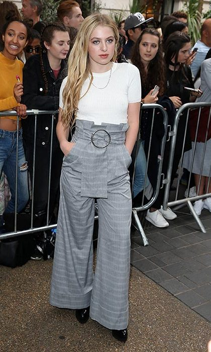 Noel Gallagher's daughter Anais, 16, was front row for the presentation, rocking wide-leg trousers and a bronze lip.