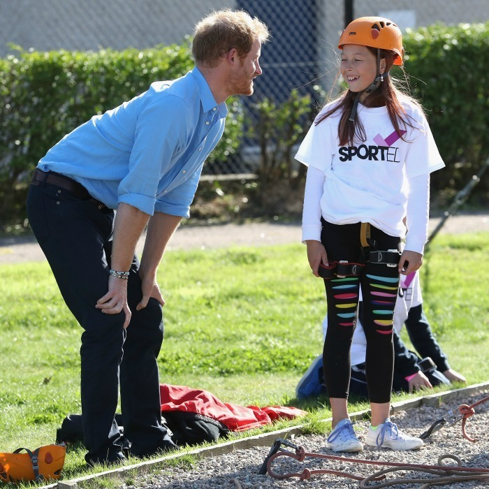 Harry offered a few words of encouragement to a young student before she participated in one of the day's activities. 