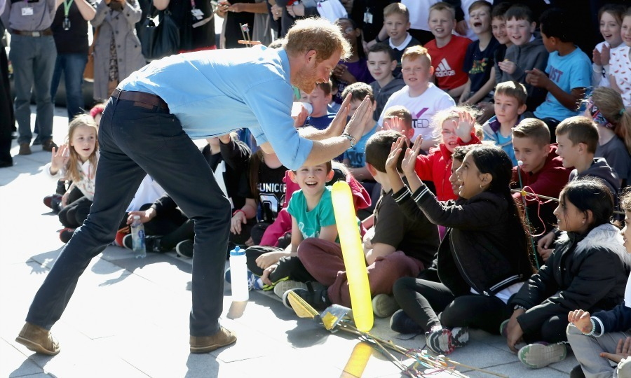 Prince Harry happily handed out high fives during his time in Aberdeenshire.