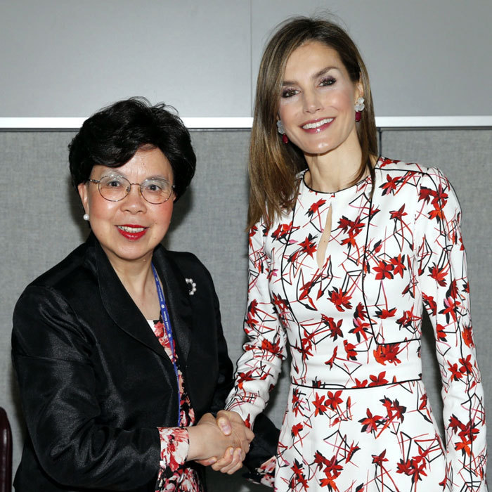 Queen Letizia looked regal in a red floral-printed dress to meet with the Director-General of the World Health Organization, Margaret Chan.