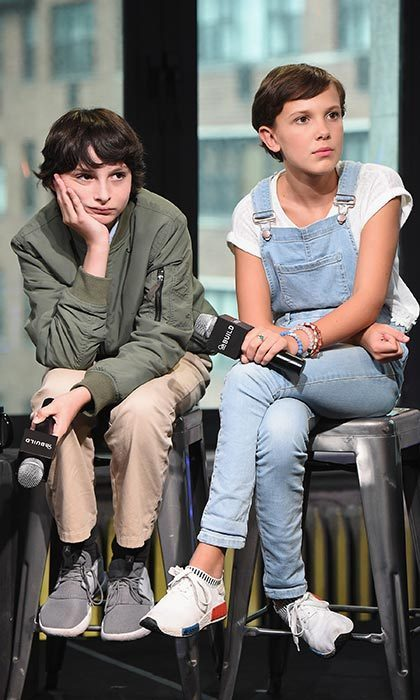 Alongside co-star Finn Wolfhard, the young actress looked on-trend sporting baby-blue denim overalls and Adidas NMD shoes for the BUILD Series at the AOL HQ in New York City.