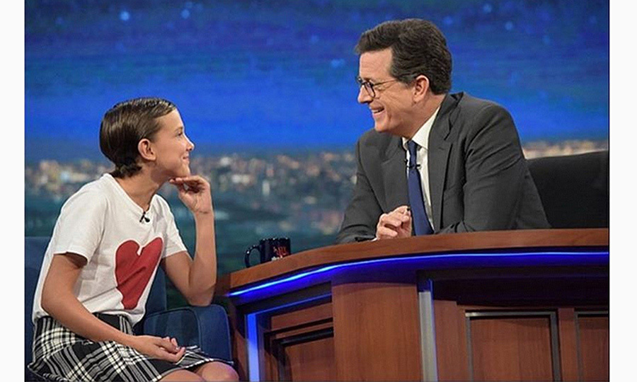 For her appearance on <em>The Late Show With Stephen Colbert</em>, Millie wore a Burberry skirt and heart t-shirt, winning the hearts of fashion fans everywhere.