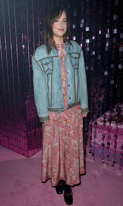Dakota Johnson joined the front row at the Gucci show in a floral dress and studded denim jacket.