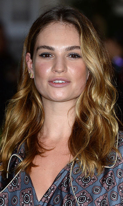 Lily James looked every inch a beauty icon for the Burberry show with her hair styled into cascading curls, opting for a hint of blusher and eyeliner for laidback glamour. 
