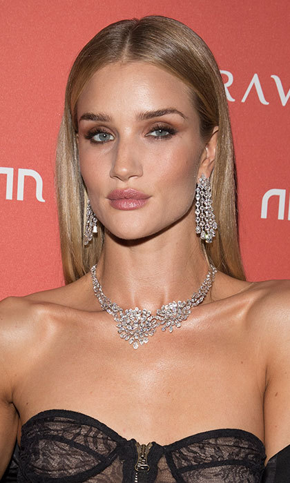 Rosie Huntington-Whiteley was the ultimate English rose with a peach-hued blusher and matte pink lips paired with sultry smoky eyeshadow as she enjoyed a night out in London. 