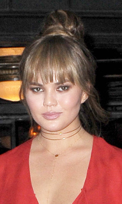 Chrissy Teigen gave us major hair goals as she debuted a gorgeous new fringe. The star documented the styling process on Snapchat as she chopped her glossy tresses into the eye-catching style. 