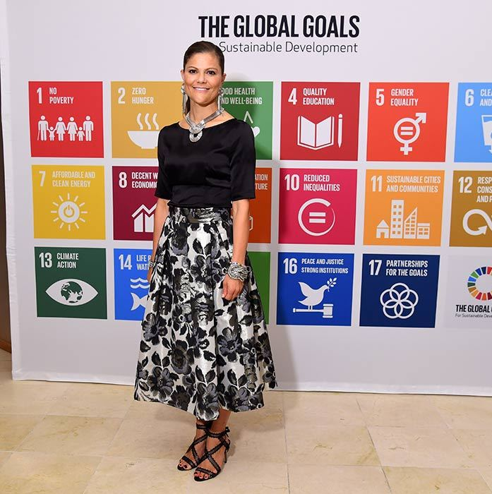 A black top and floral midi skirt create a smart yet stylish look for Princess Victoria's appearance at the 2016 Global Goals Awards Dinner.