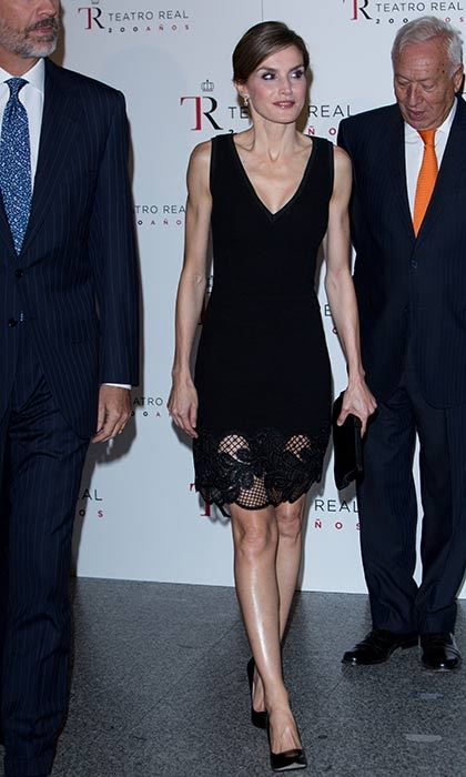 Queen Letizia goes for glamour in a black lace hem dress.