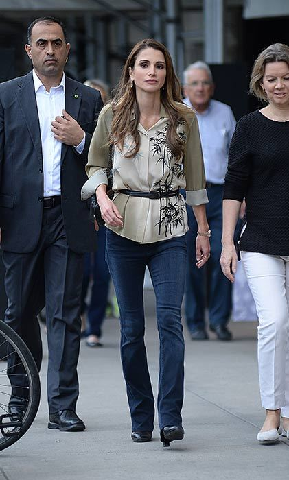 Queen Rania explores New York in style wearing bootcut jeans and a palm tree printed shirt.