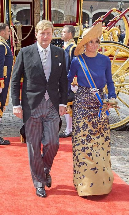 Queen Maxima made a regal appearance at Budget day in a cobalt and gold gown and statement hat.