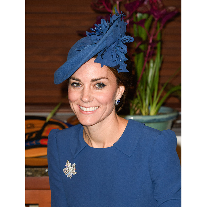 On the first day of the royal visit to Canada, Kate paid tribute to the host country by wearing a royal blue Lock & Co hat adorned with maple leafs. 